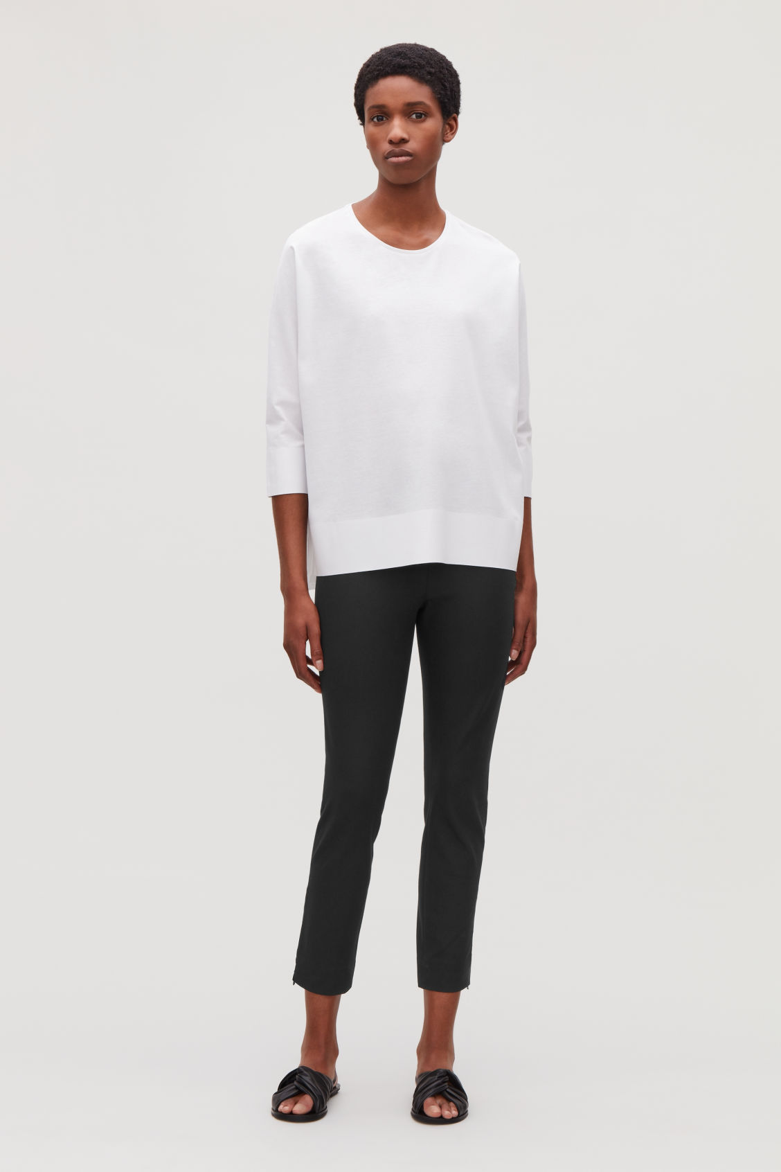 Model front image of Cos trousers with ankle zips  in black