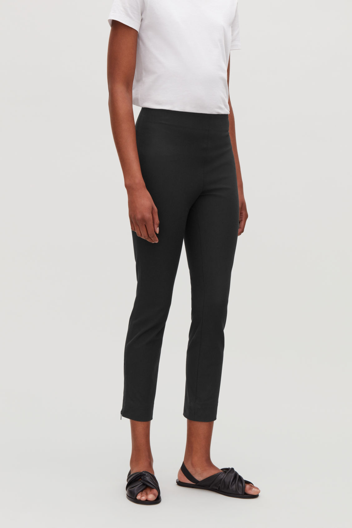 Model side image of Cos trousers with ankle zips  in black