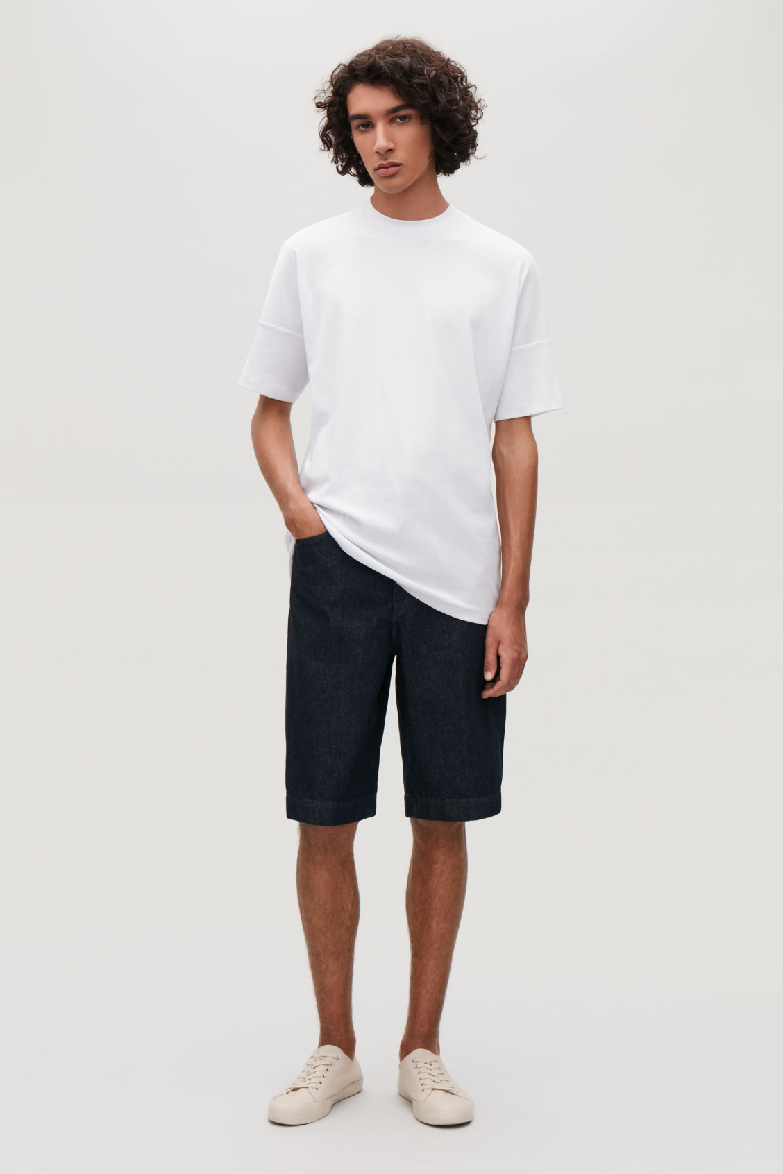 Model front image of Cos diagonal-ribbed t-shirt in white