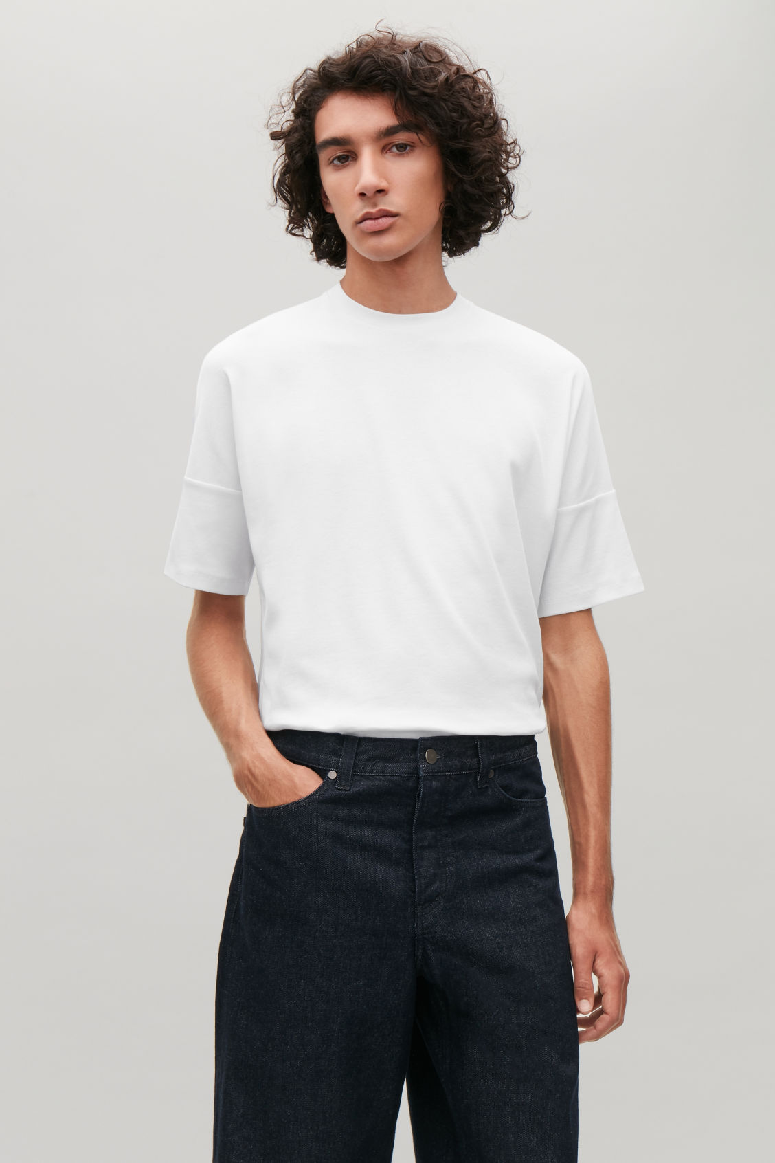 Model side image of Cos diagonal-ribbed t-shirt in white