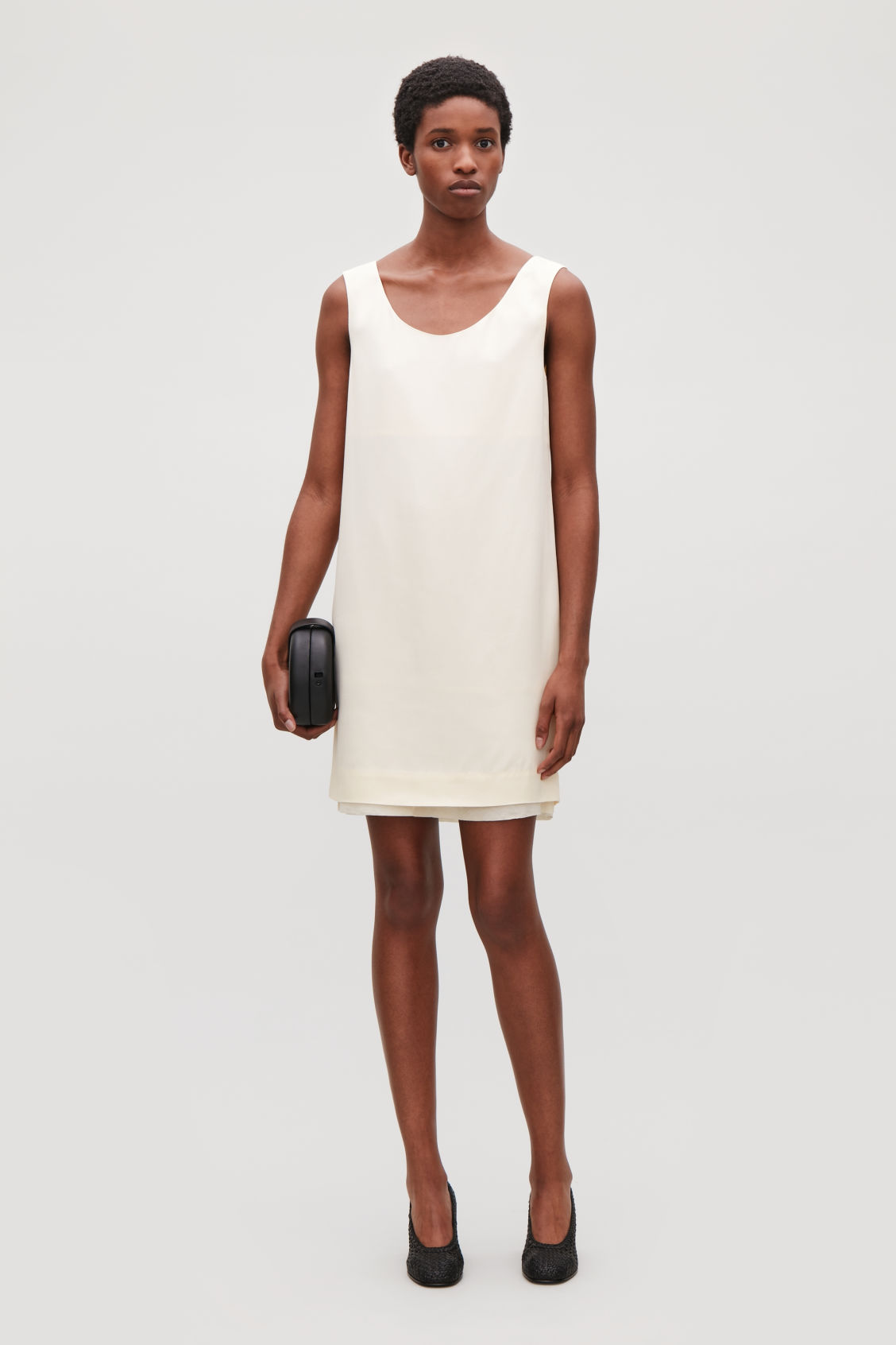 Model front image of Cos short sleeveless dress in neutral