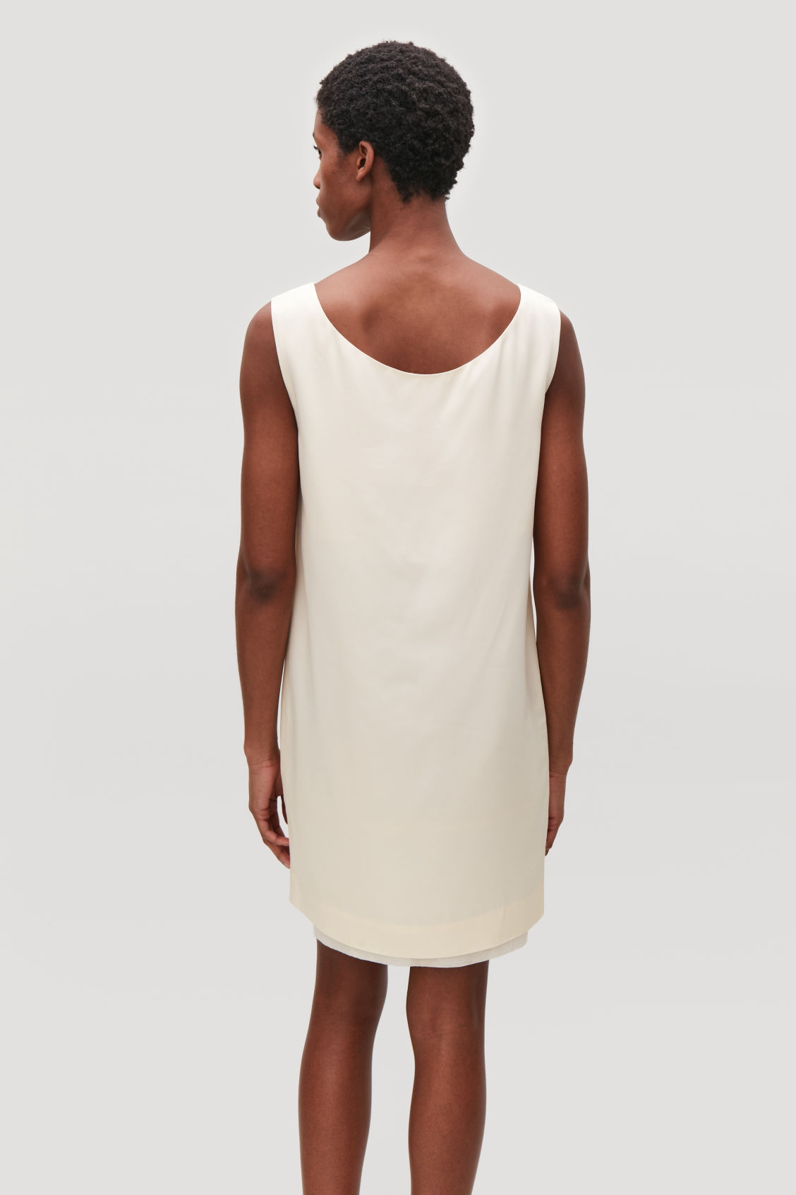 Model side image of Cos short sleeveless dress in neutral