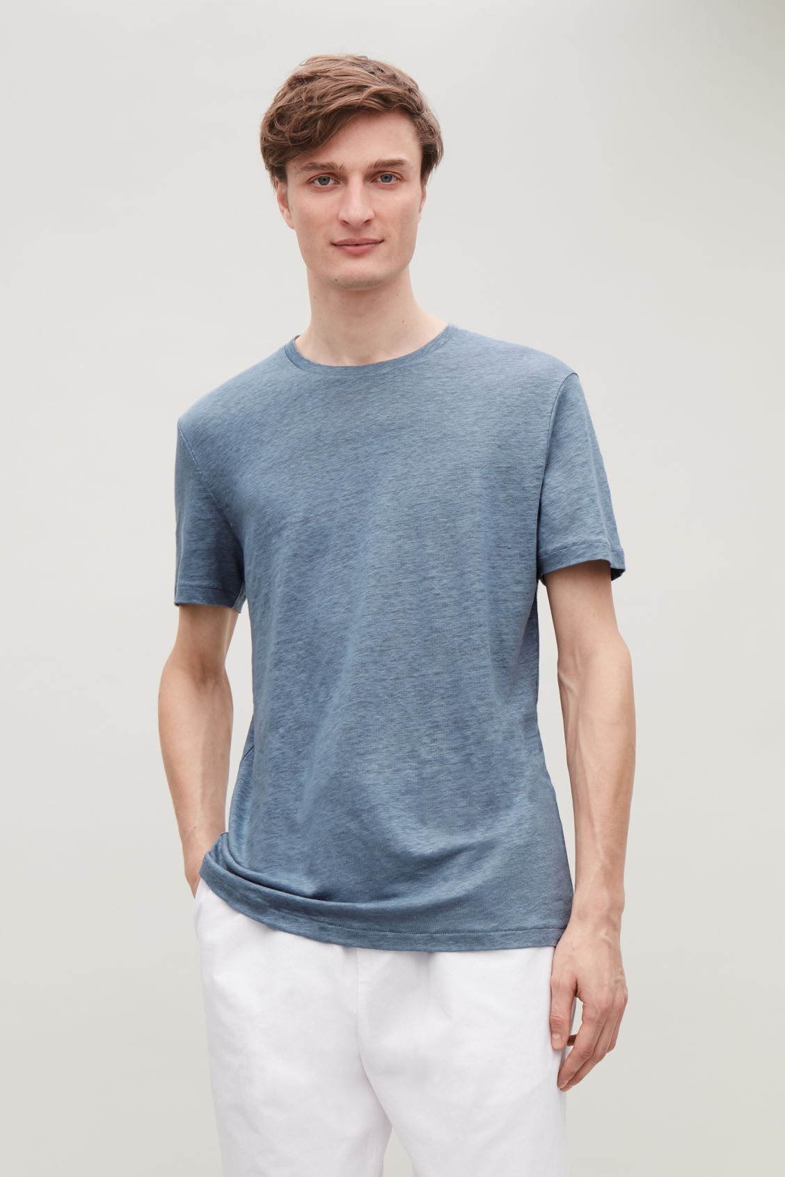 Model side image of Cos short-sleeved linen t-shirt in blue