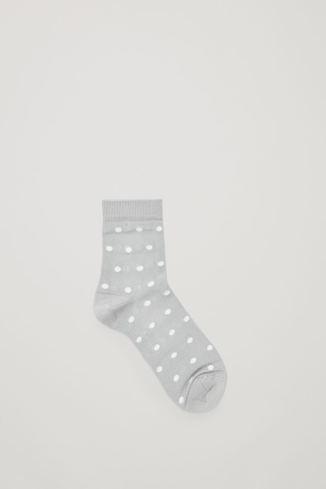Model front image of Cos polka-dot socks in grey