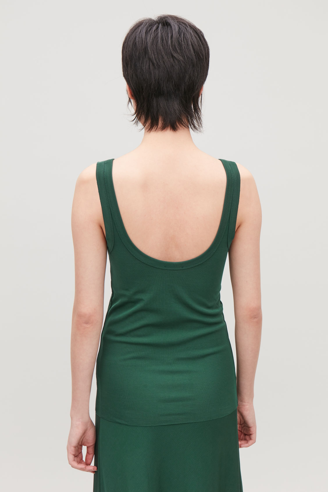 Model side image of Cos low-back ribbed vest in green