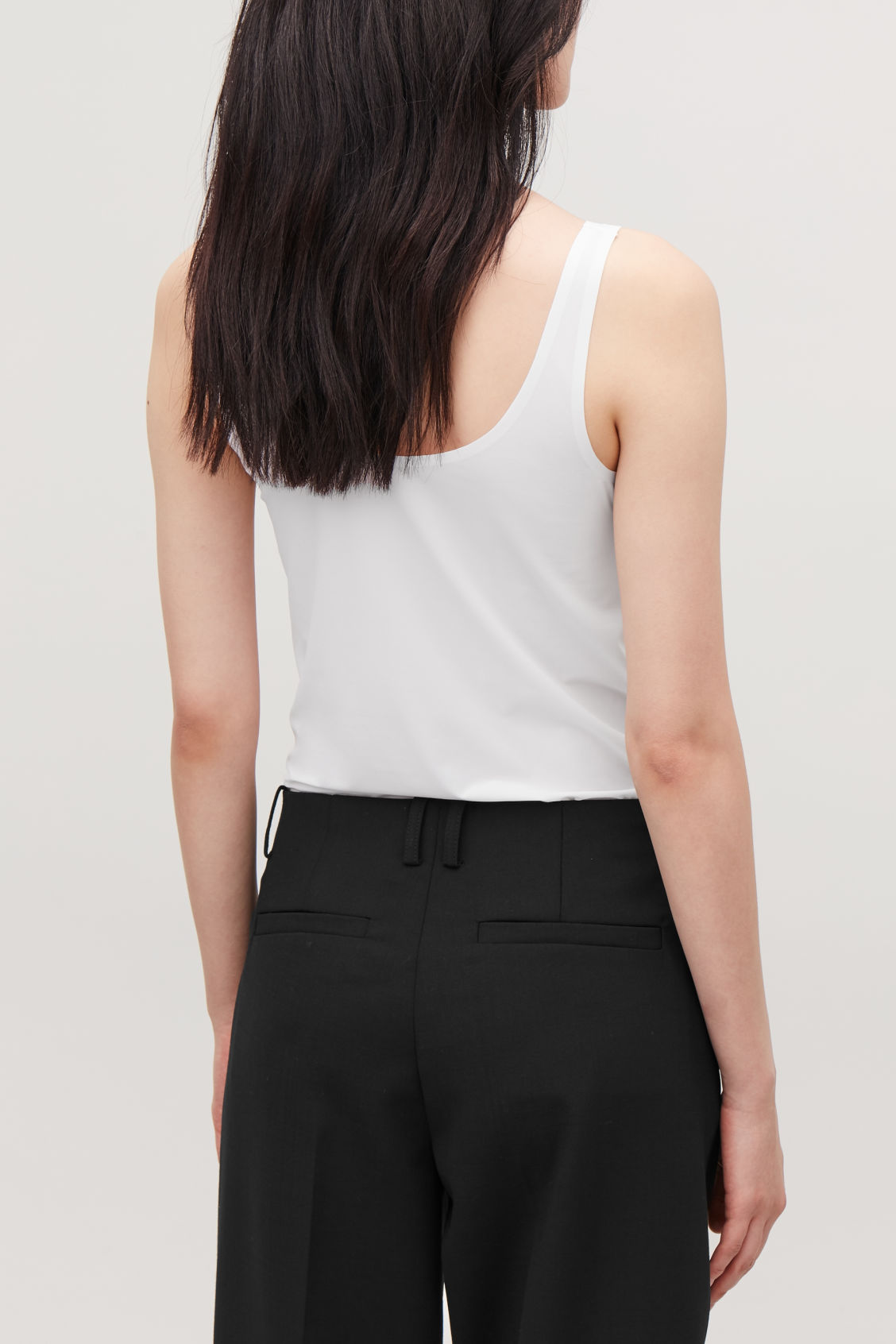 Model side image of Cos seamless vest top  in white