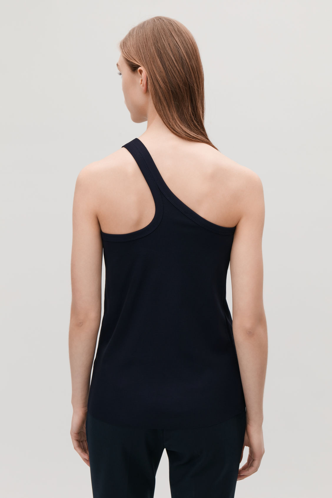Model side image of Cos one-shoulder jersey top in blue