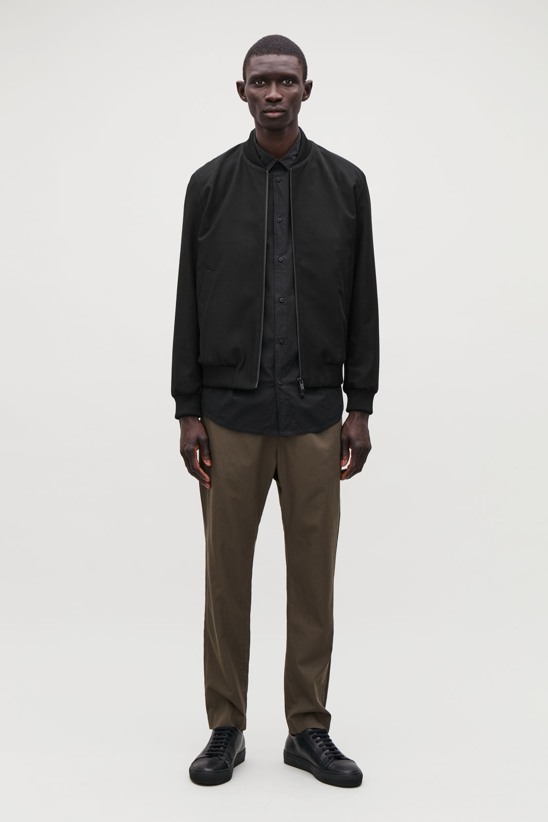 Model front image of Cos cotton bomber jacket in black