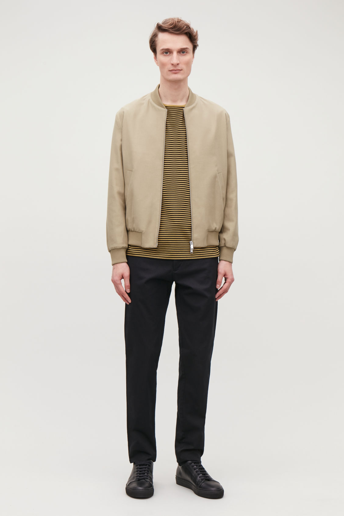 Model side image of Cos cotton bomber jacket in beige