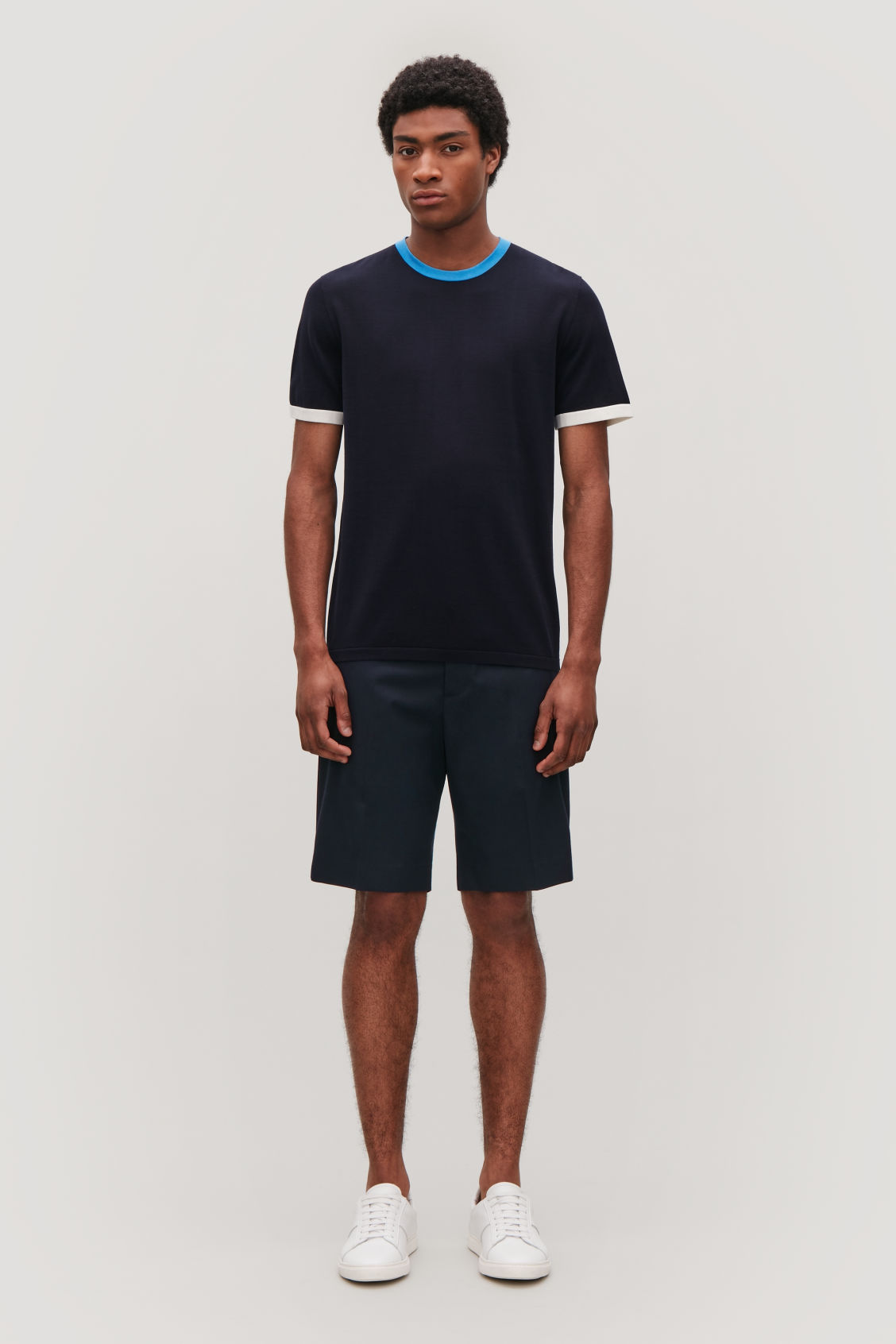 Model front image of Cos slim-fit chino shorts in blue