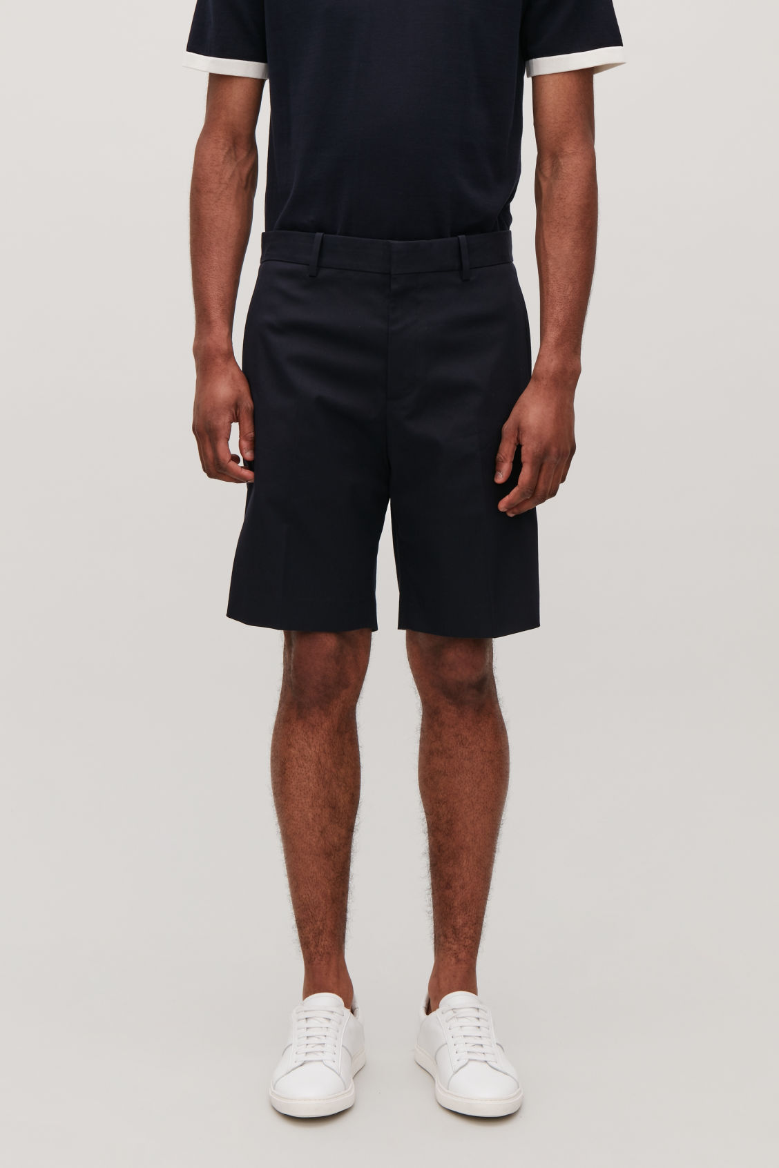 Model side image of Cos slim-fit chino shorts in blue