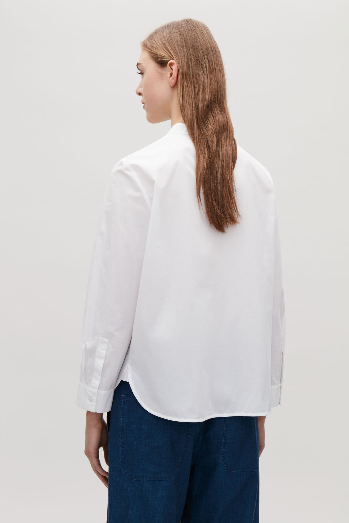 Model side image of Cos grandad-collared poplin shirt  in white