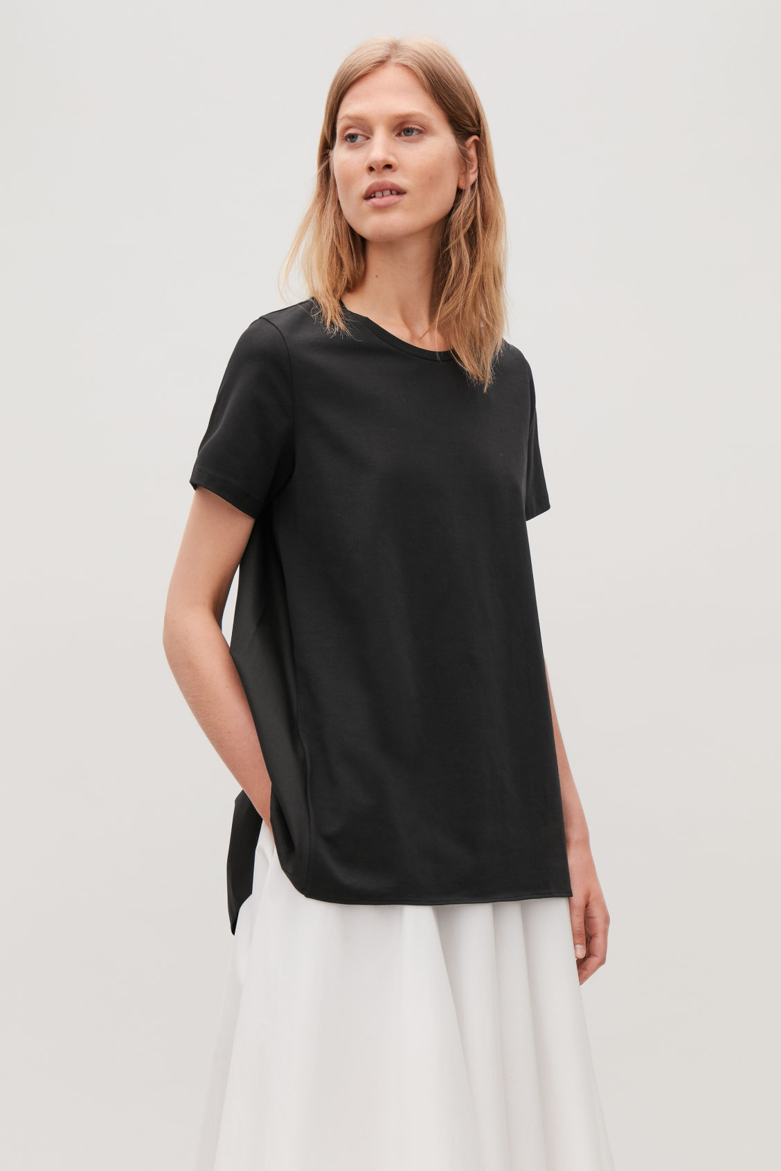 Model side image of Cos short-sleeved a-line top in black