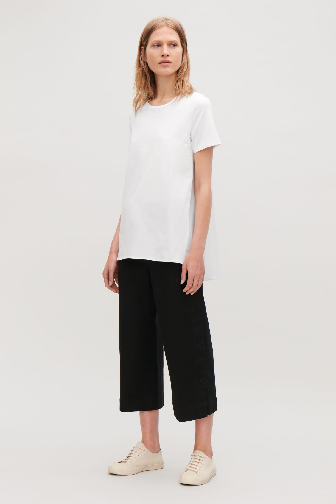 Model front image of Cos short-sleeved a-line top in white