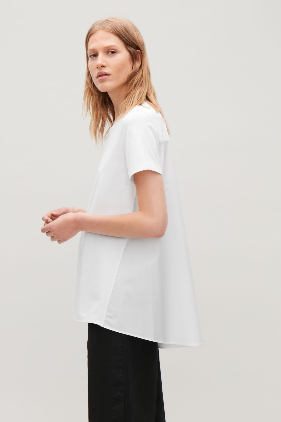 Model side image of Cos short-sleeved a-line top in white