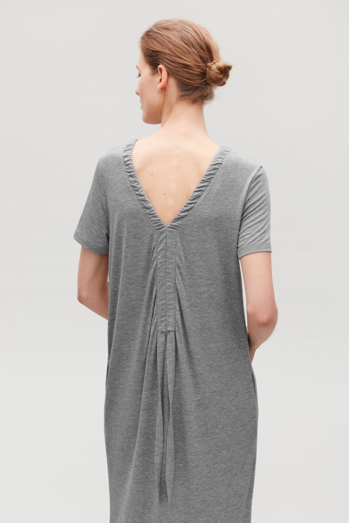 Model side image of Cos long gathered jersey dress in grey