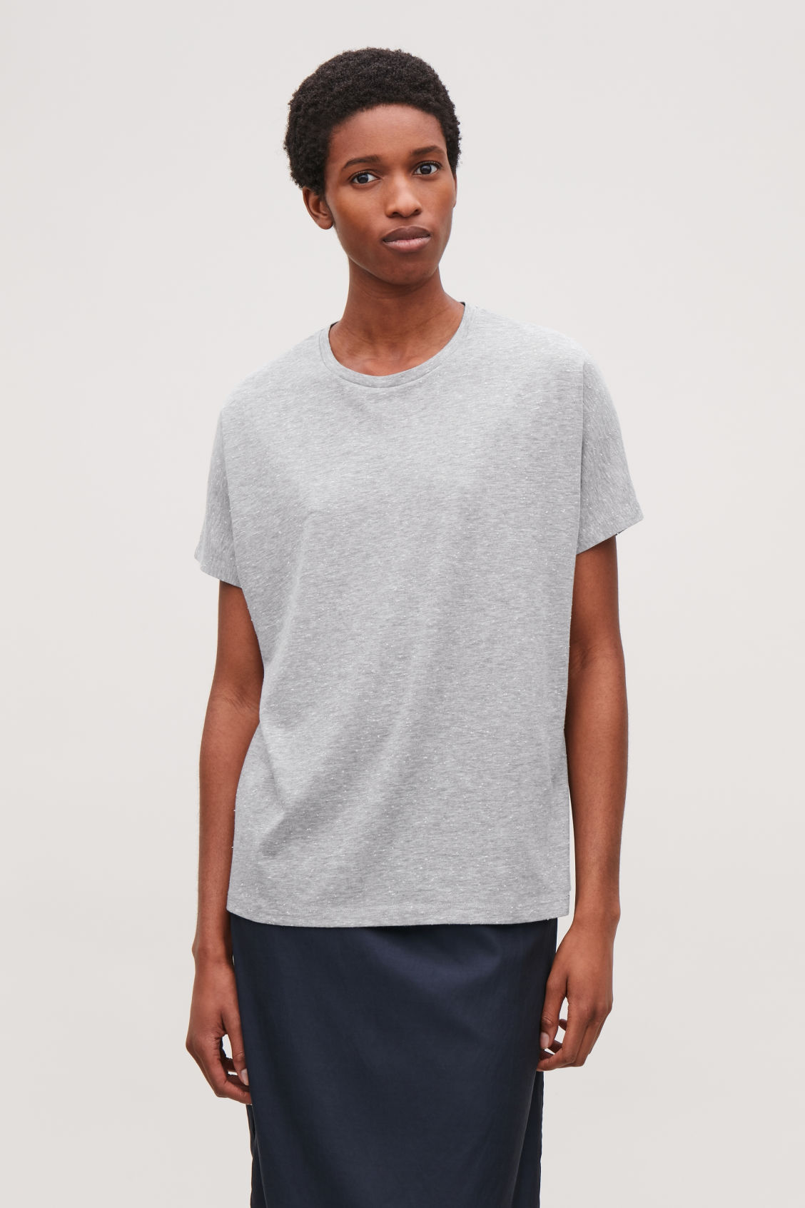 Model side image of Cos oversized speckled t-shirt in grey