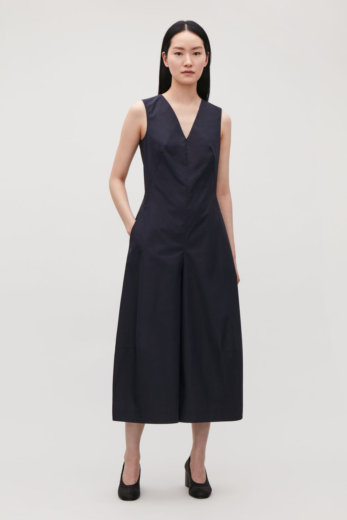 Model front image of Cos wide-leg jumpsuit with v-neck in blue