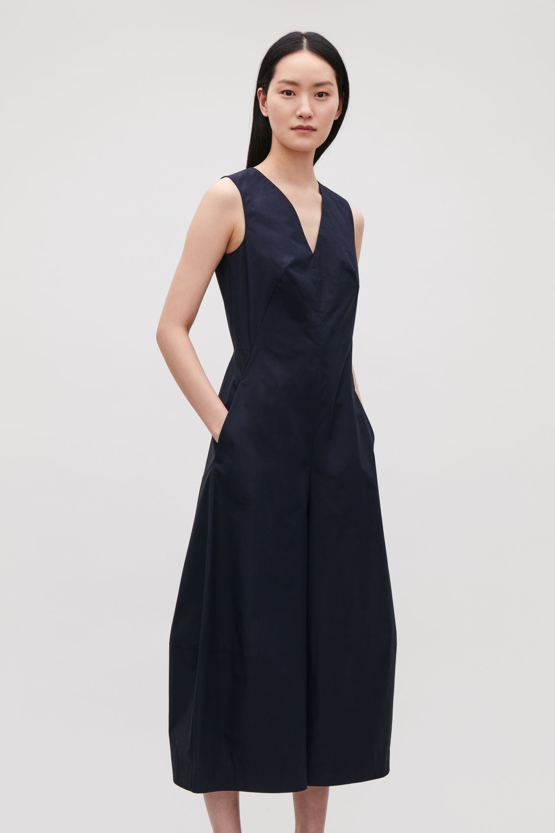 Model side image of Cos wide-leg jumpsuit with v-neck in blue