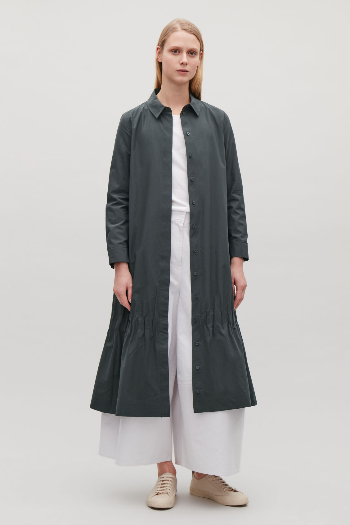 Model side image of Cos shirt dress with gathered hem  in grey