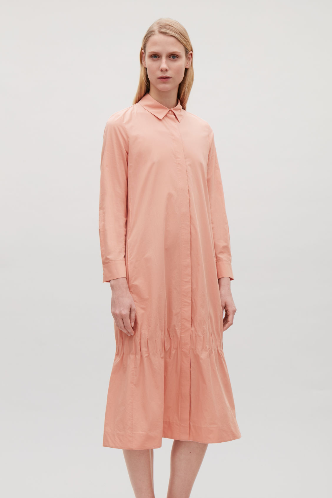 Model side image of Cos shirt dress with gathered hem  in pink