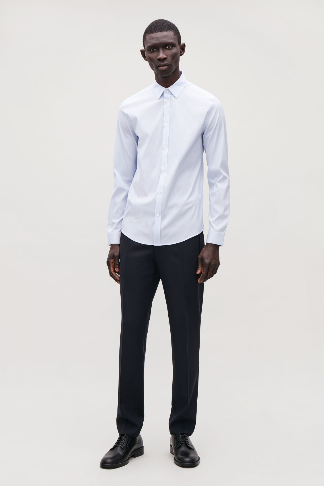 Model front image of Cos pinstriped stretch-cotton shirt  in blue