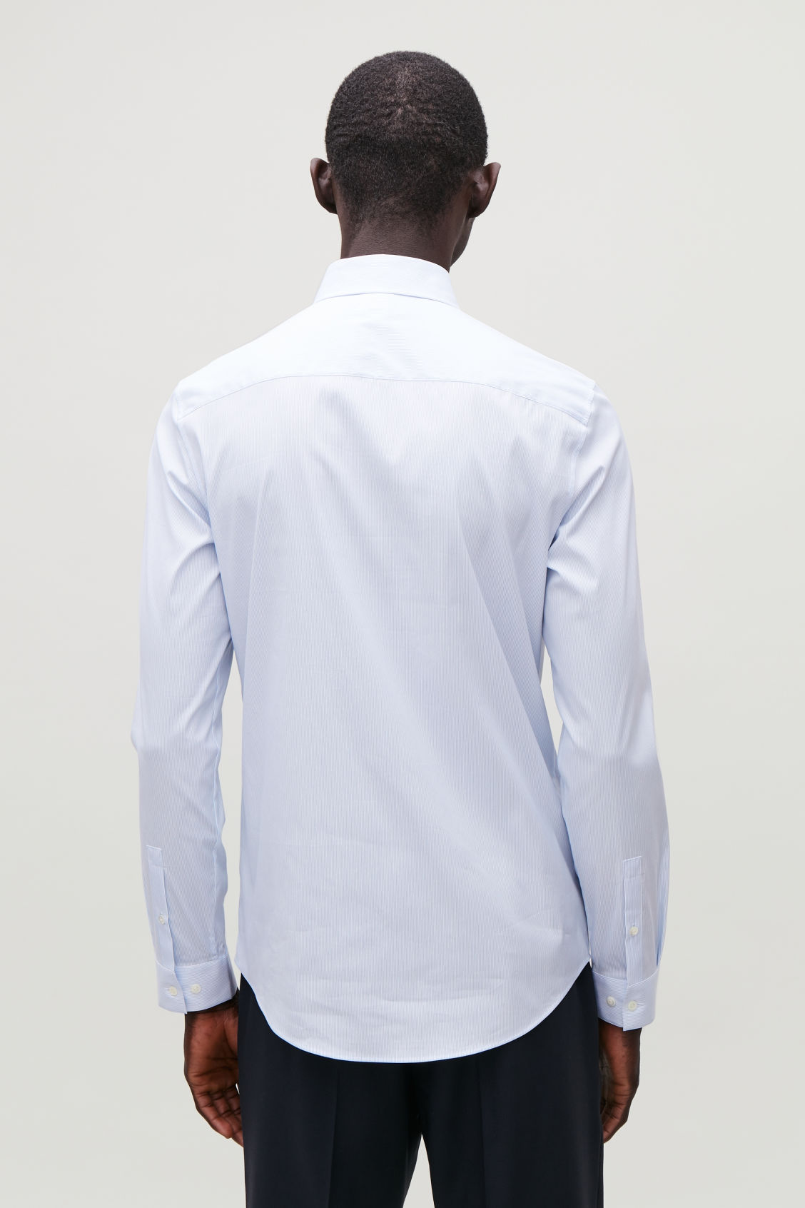 Model side image of Cos pinstriped stretch-cotton shirt  in blue