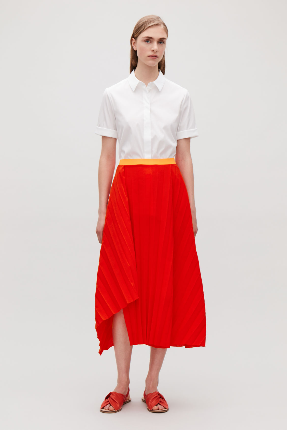 Model front image of Cos pleated asymmetric skirt in red