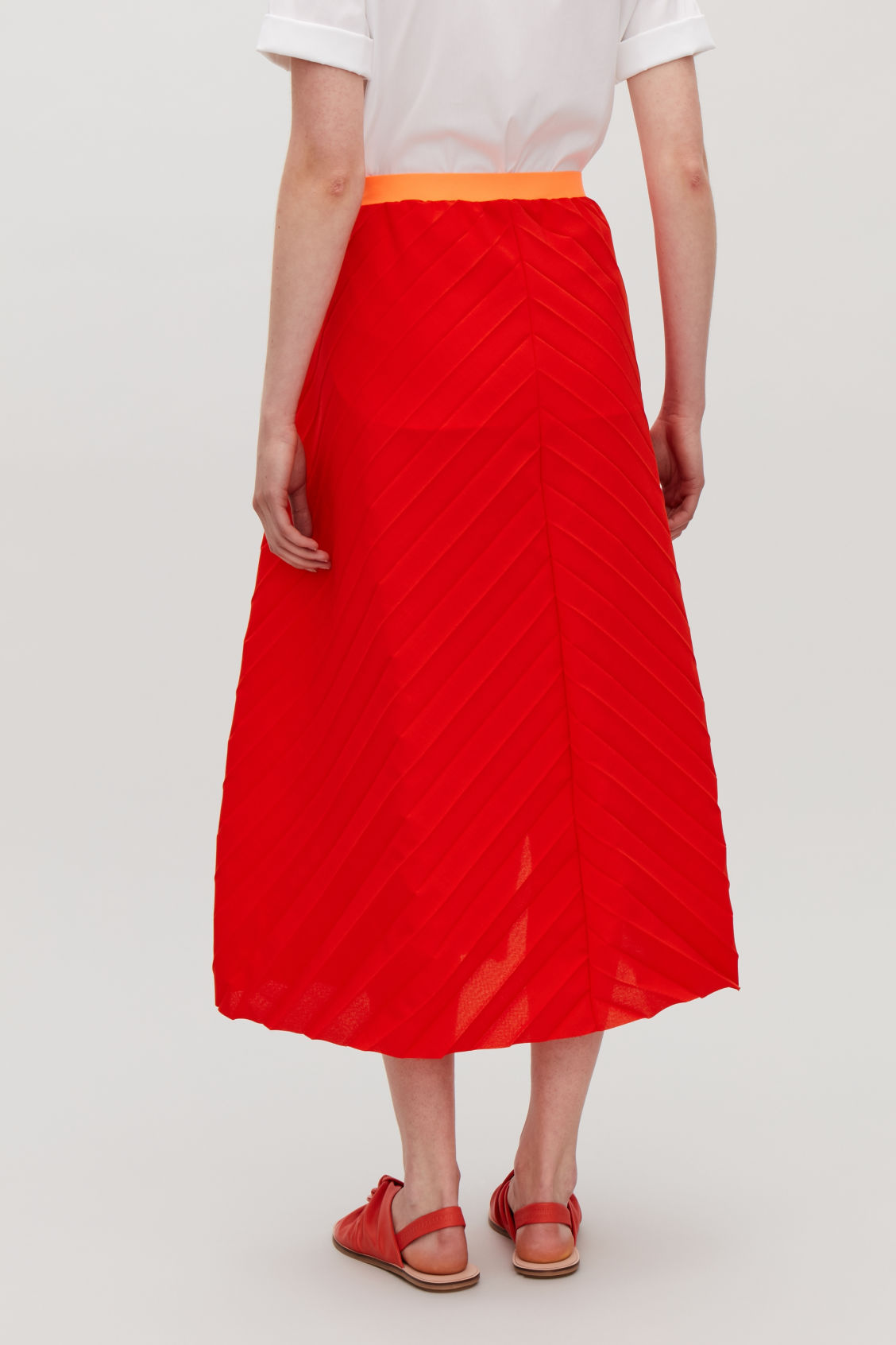 Model side image of Cos pleated asymmetric skirt in red
