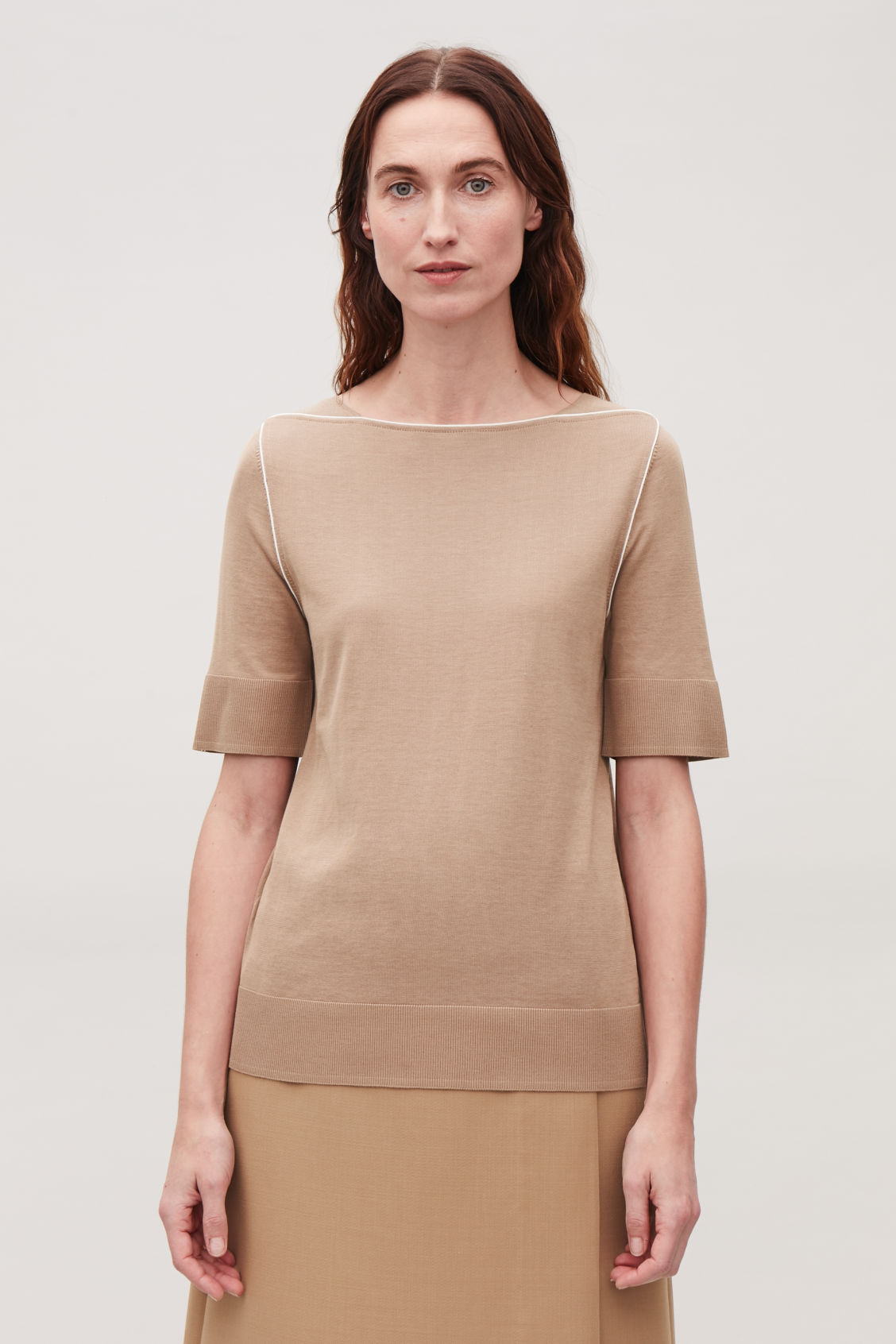Model side image of Cos silk-blend knit top with piping in beige