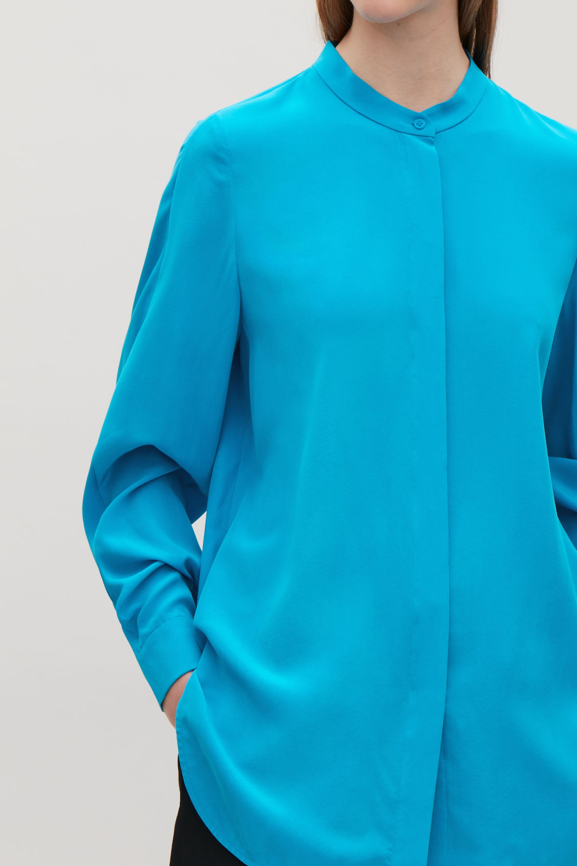 Model side image of Cos grandad-collared silk shirt in turquoise