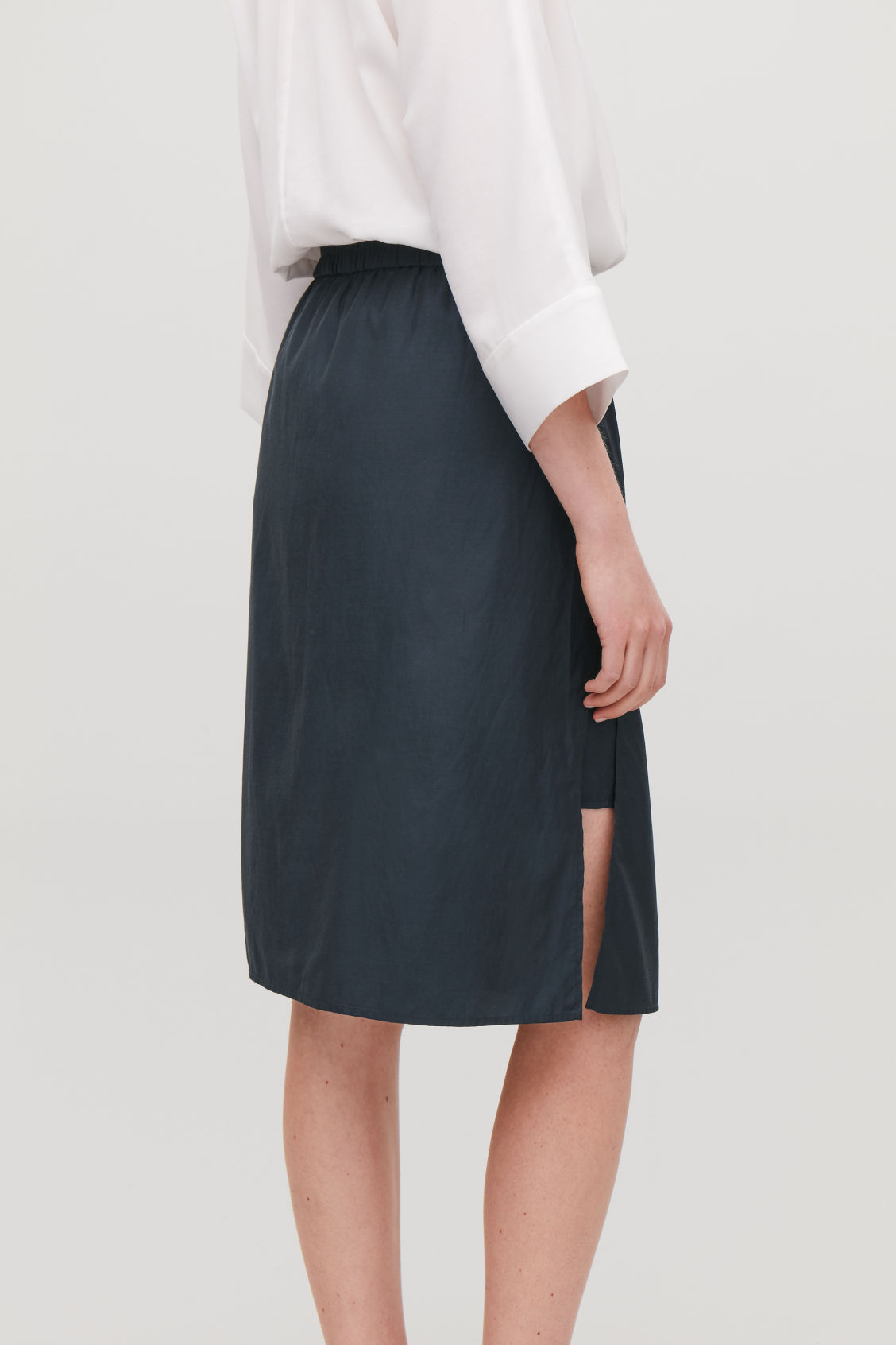 Model side image of Cos draped double-layered skirt in blue