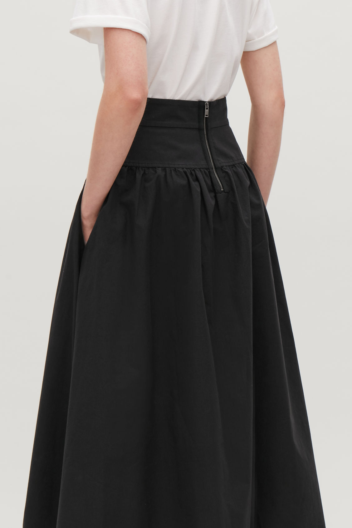 Model side image of Cos voluminous poplin panelled skirt in black