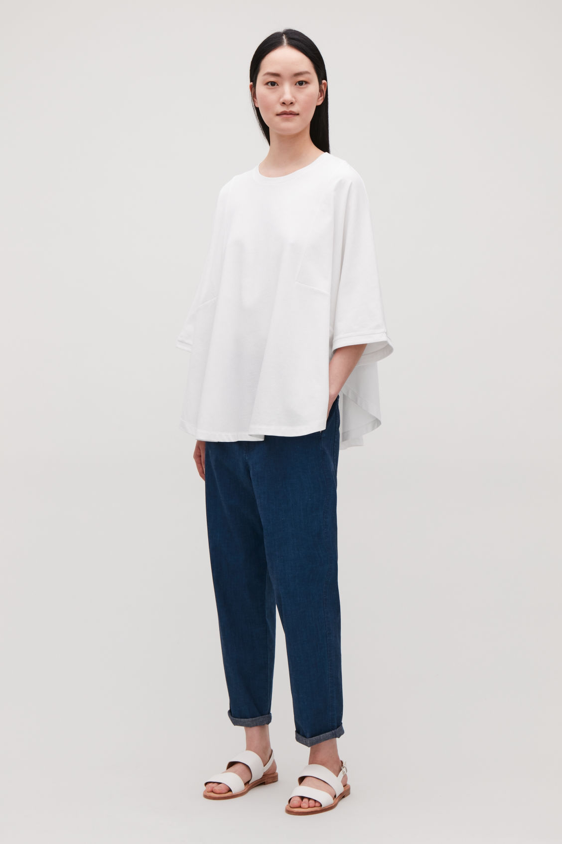 Model front image of Cos circle-cut t-shirt in white