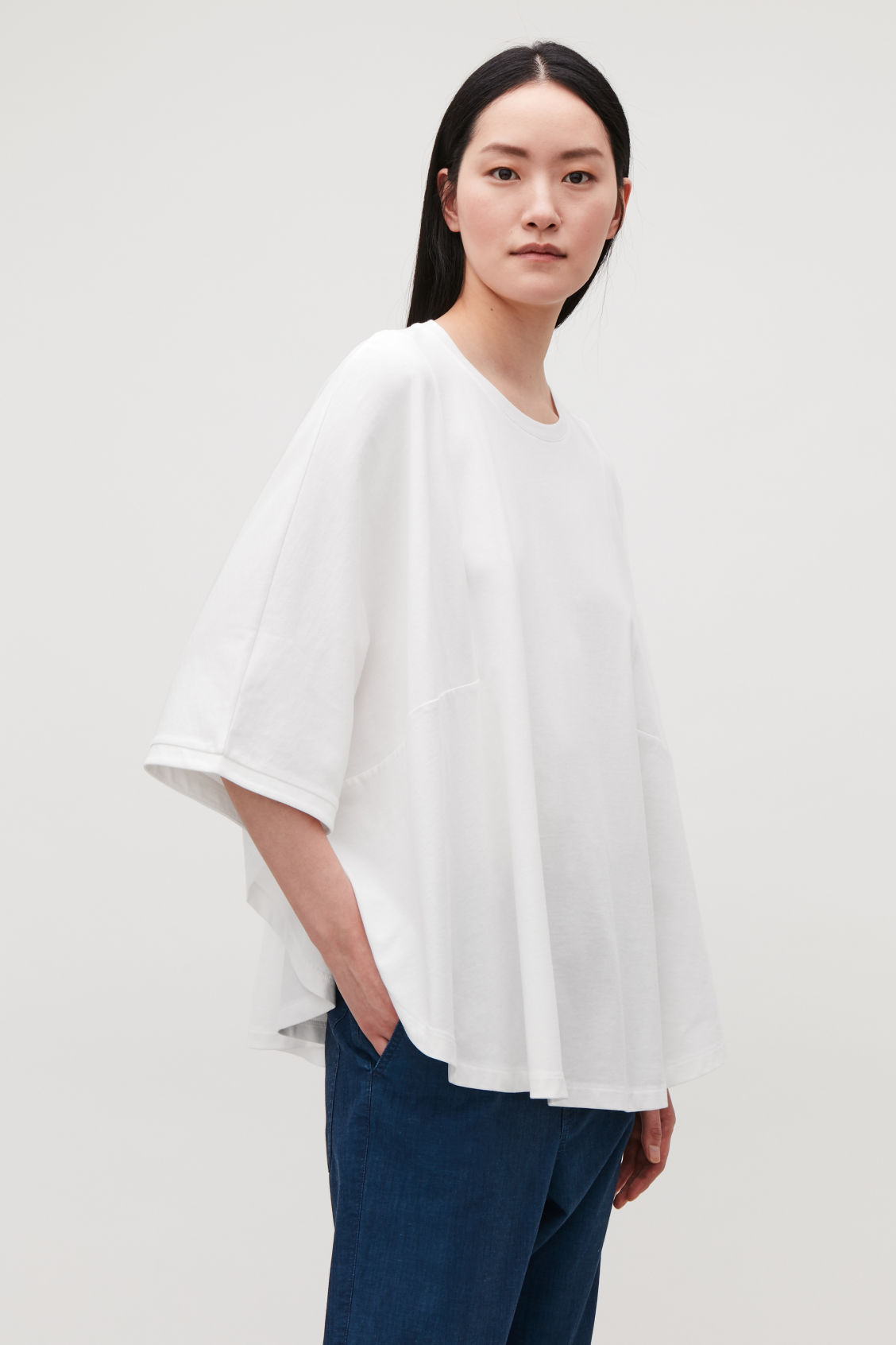 Model side image of Cos circle-cut t-shirt in white