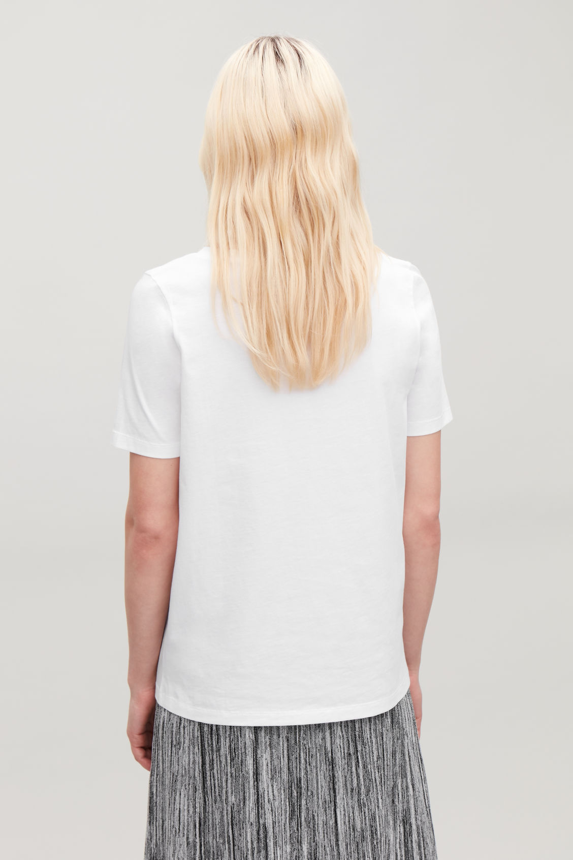 Model side image of Cos wide v-neck t-shirt in white