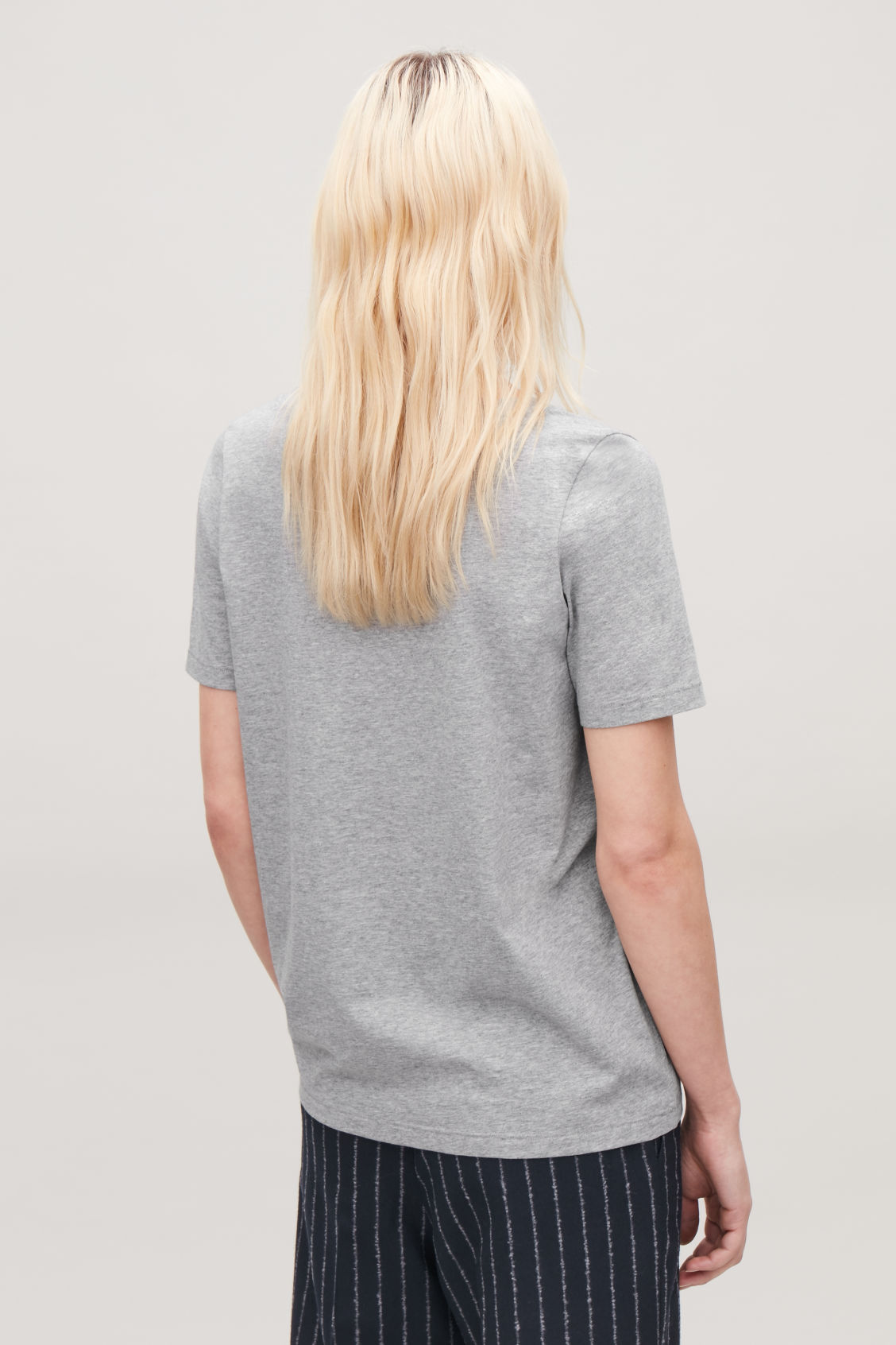 Model side image of Cos wide v-neck t-shirt in grey