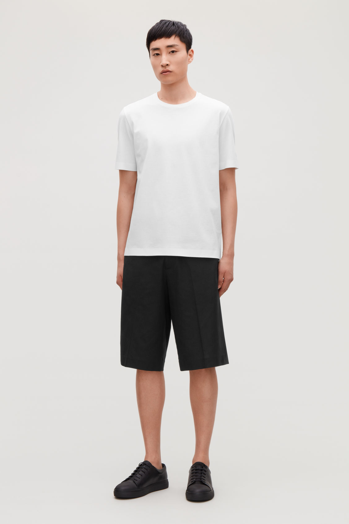 Model side image of Cos wide tailored shorts in black