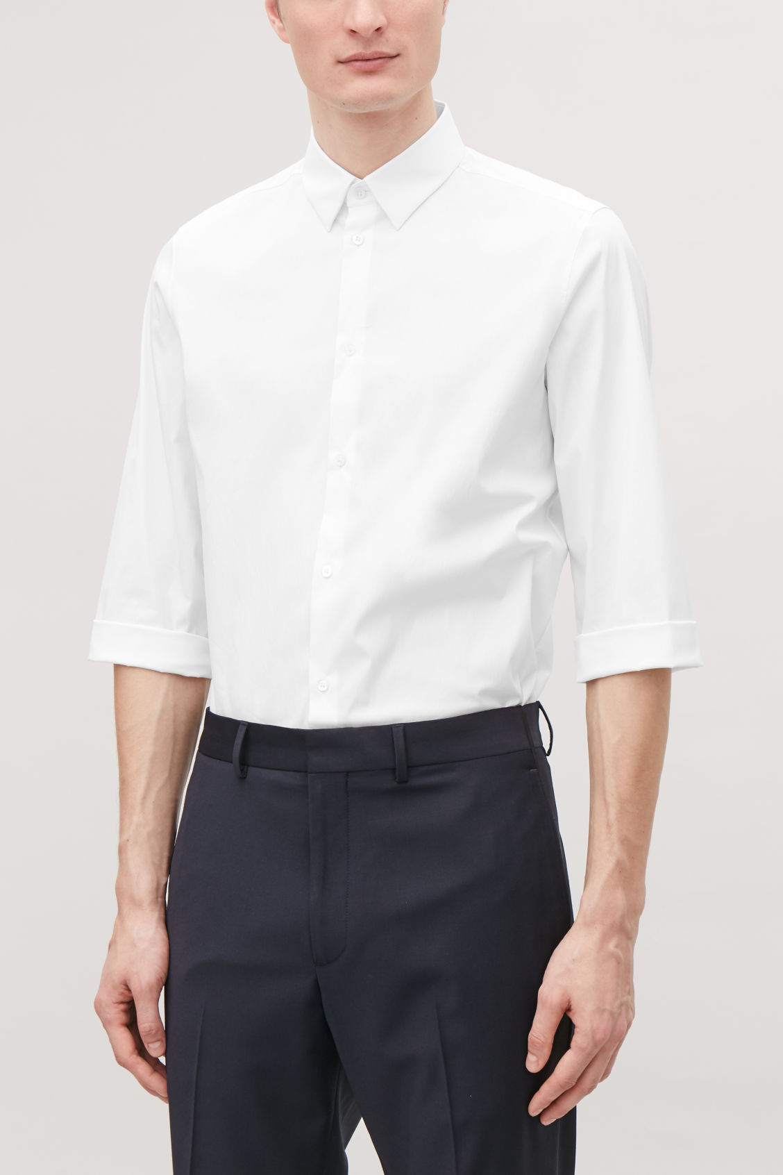Model side image of Cos ¾-sleeved cotton shirt in white