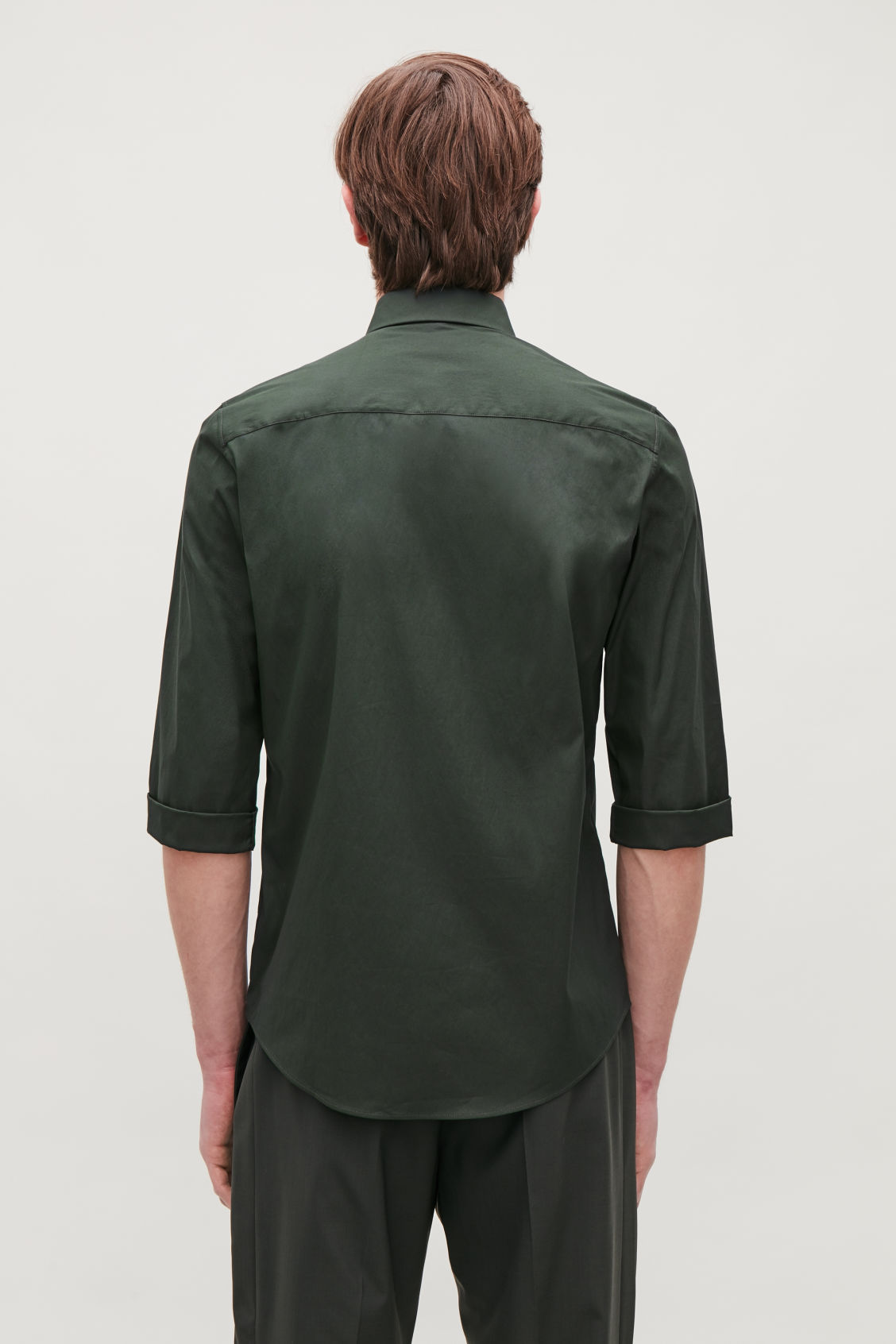 Model side image of Cos ¾-sleeved cotton shirt in green
