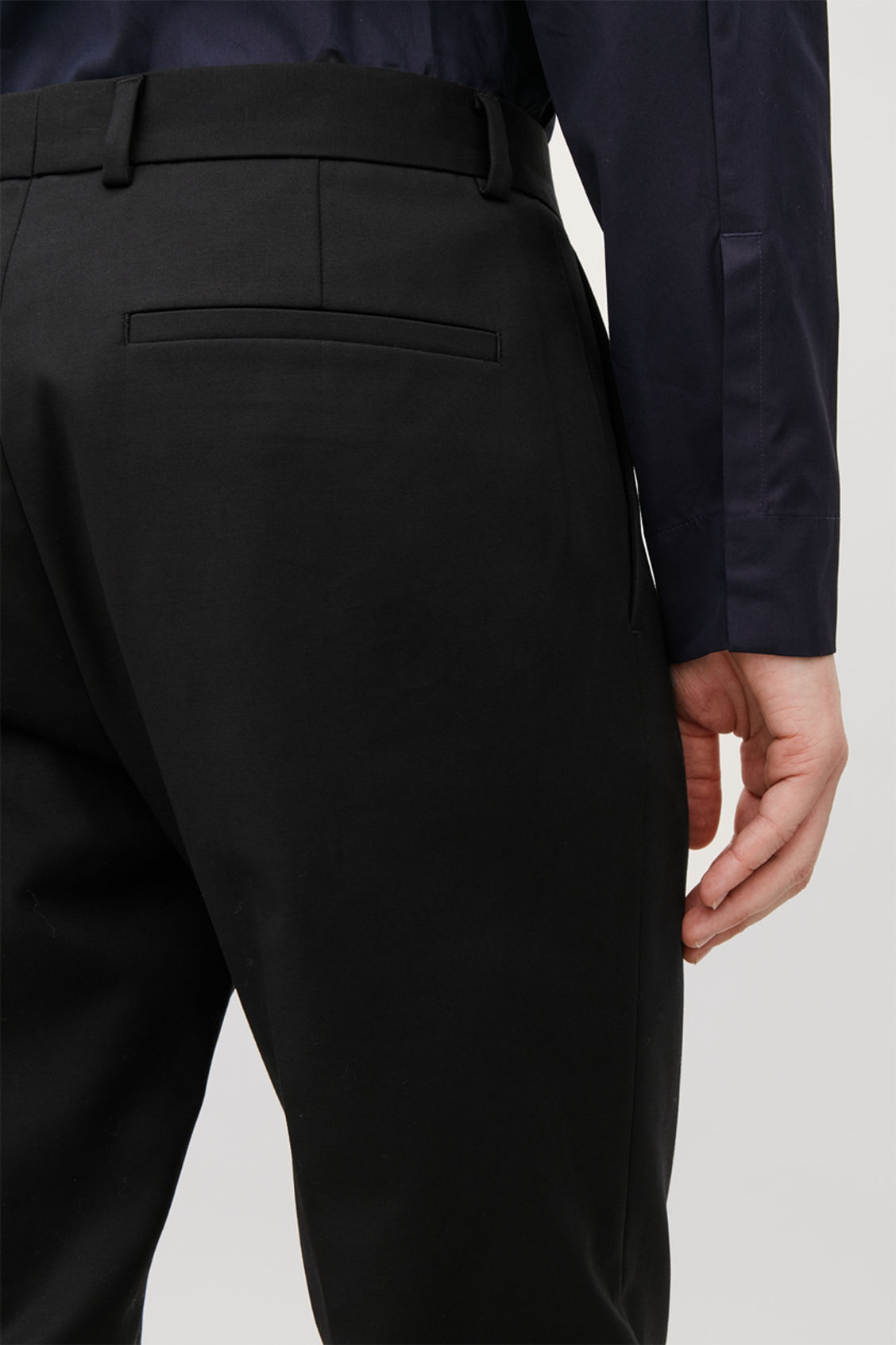Model side image of Cos skinny stretch-cotton trousers in black