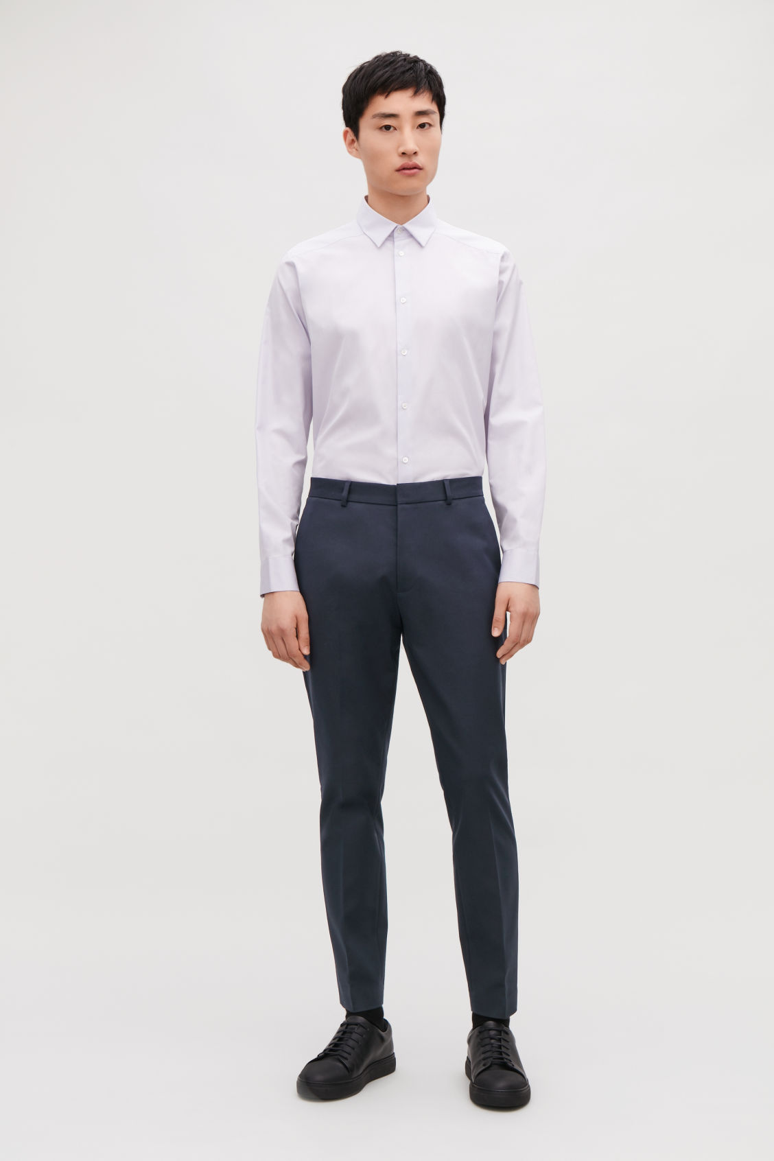 Model front image of Cos skinny stretch-cotton trousers in blue