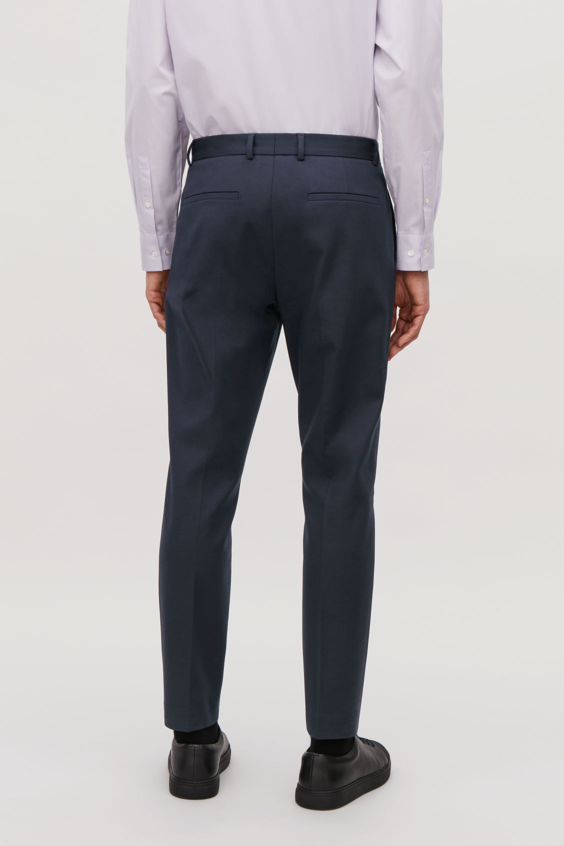 Model side image of Cos skinny stretch-cotton trousers in blue
