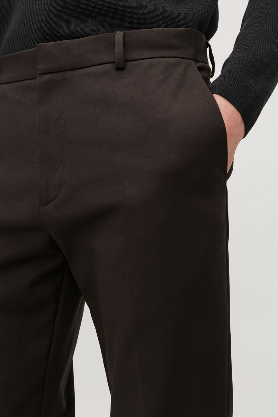 Model side image of Cos skinny stretch-cotton trousers in brown