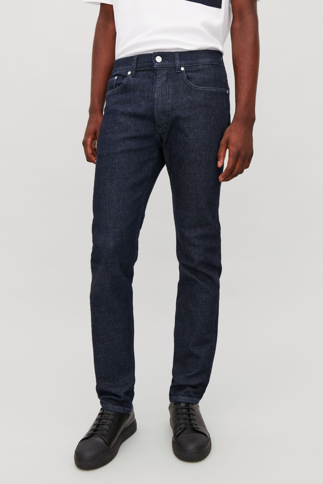 Model side image of Cos slim-fit jeans in blue