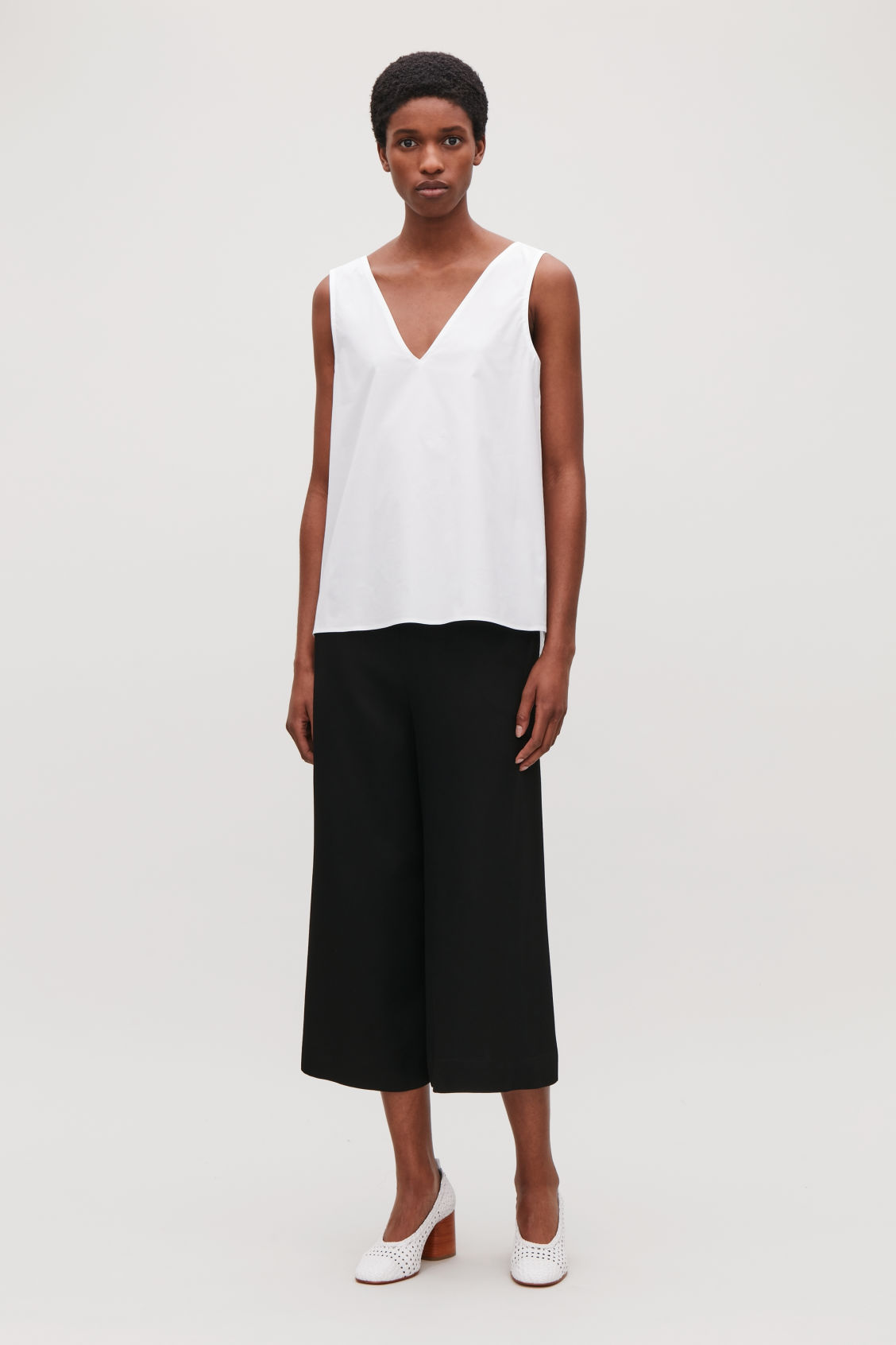 Model front image of Cos low v-neck pleated top in white