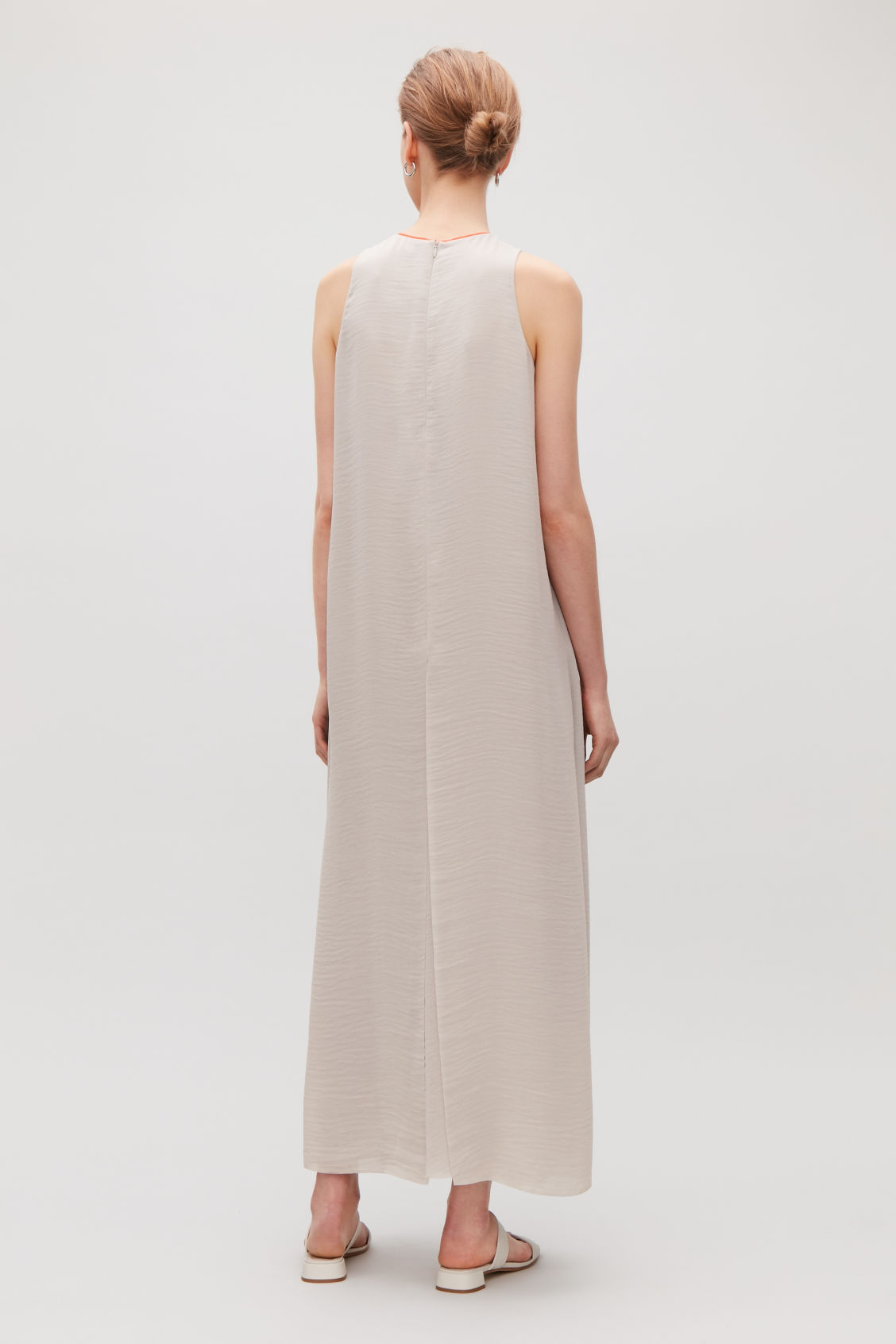 Model side image of Cos sleeveless dress with slits in brown