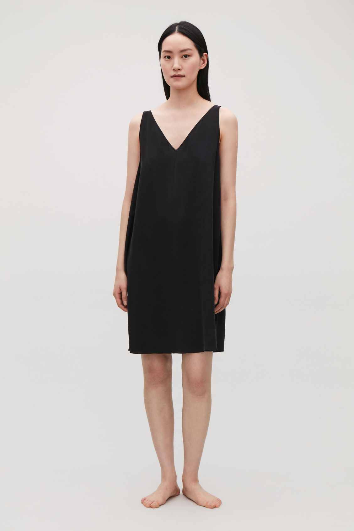 Model front image of Cos sleeveless silk dress in black