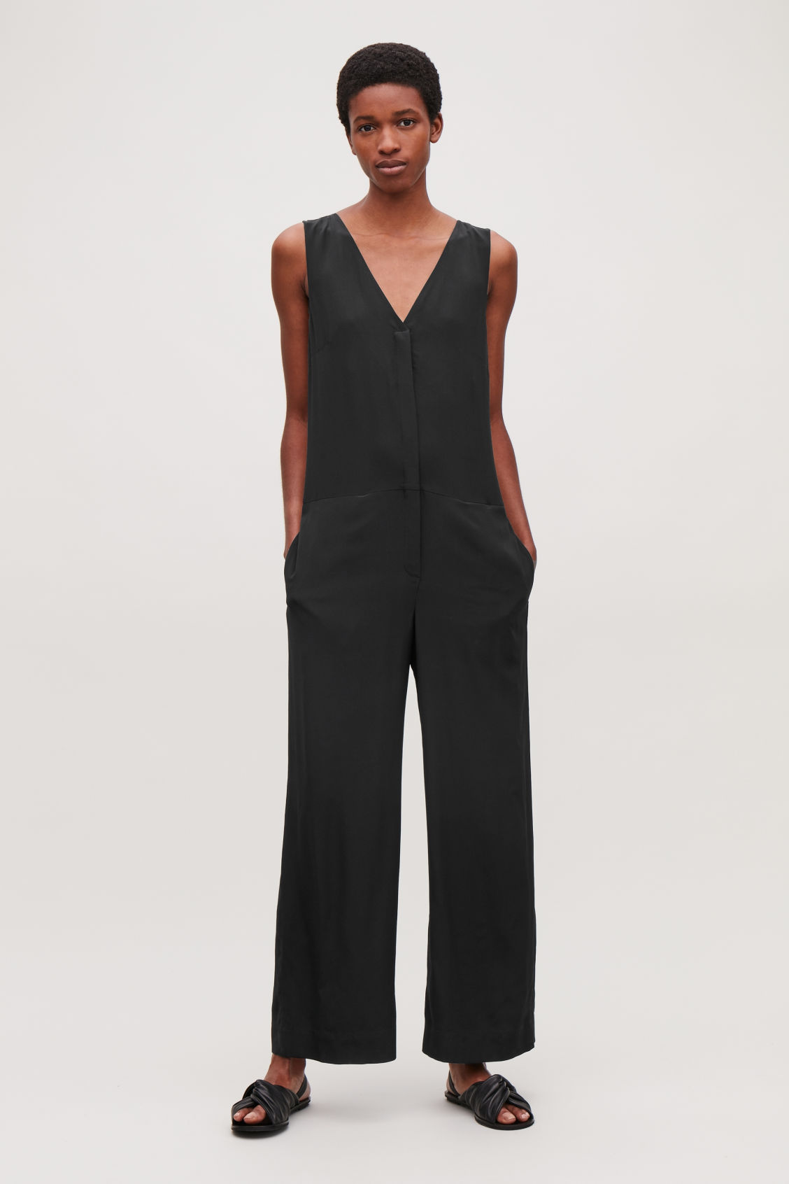 Model front image of Cos silk jumpsuit in black