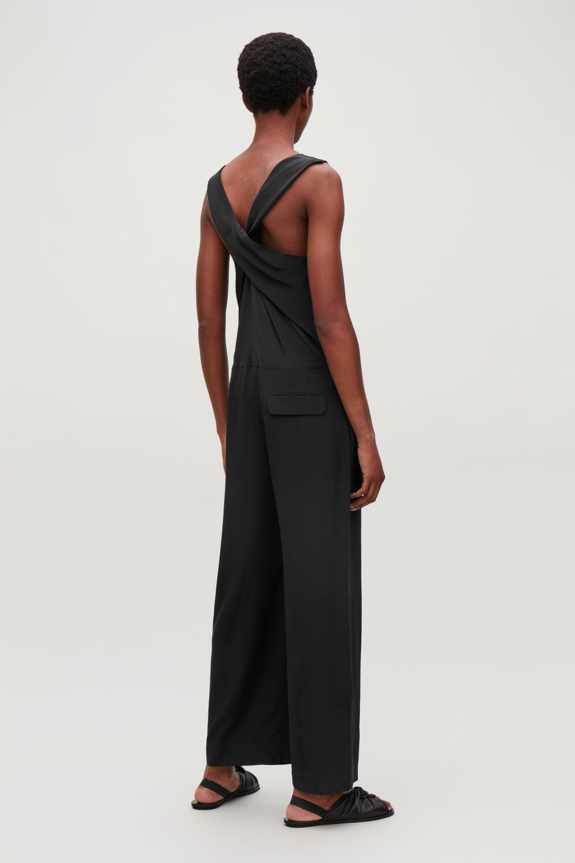 Model side image of Cos silk jumpsuit in black